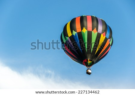 ST. LOUIS - SEPTEMBER 20: A hot air balloon ascends over Forest Park at the 42nd Great Forest Park Balloon Race on September 20, 2014 in St. Louis. - stock photo