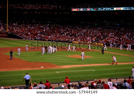 ST. LOUIS - SEPTEMBER 27: Benches empty, but no brawl breaks out in a game between the St. Louis Cardinals and Cincinnati Reds at new Busch Stadium September 27, 2008 in St. Louis, MO - stock photo