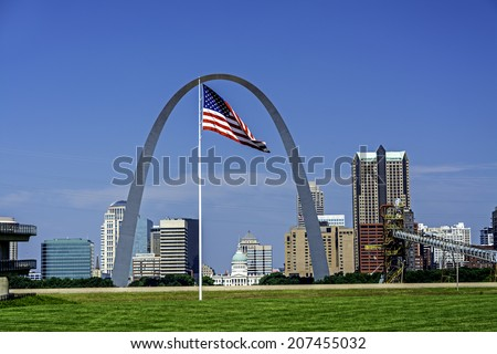 St. Louis Skyline Arch and American Flag - stock photo
