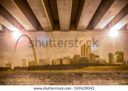 St. Louis skyline as wall drawing on the support column of an overpass - stock photo