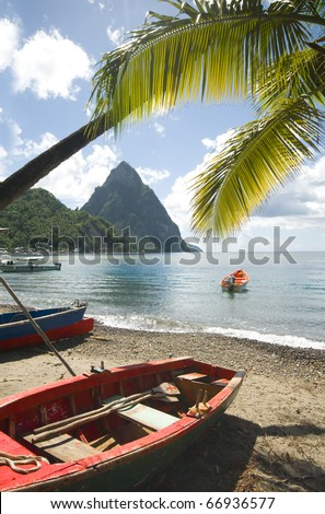 St. Lucia island view of famous twin piton mountain peaks from Soufriere beach native fishing boats in Caribbean Sea - stock photo
