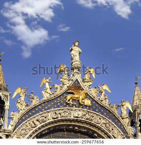 St. Marco cathedral with the statues of St. Marco and Angels, San Marco Square, Venice, Italy - UNESCO World Heritage Site - stock photo