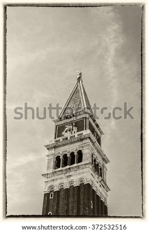 St Mark's Campanile (Campanile di San Marco) - famous bell tower of St Mark's Basilica. Piazza San Marco, Venice, Italy. Old photo Style. - stock photo
