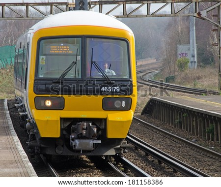 ST MARY CRAY, KENT, UK - 8 MAR 2014: Southeastern Railways type 465 electric multiple unit arriving at St Mary Cray Station en route for London Victoria. - stock photo