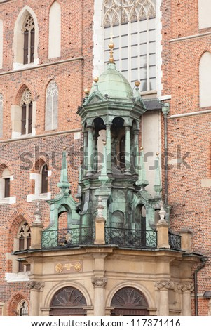 St. Mary's Basilica is a Brick Gothic church re-built in the 14th century (originally built in the early 13th century), adjacent to the Main Market Square in Krak���³w, Poland. - stock photo