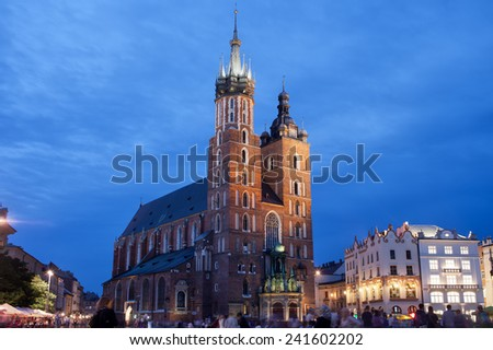 St Mary's Basilica (Mariacki Church) at night in the Old Town of Krakow in Poland. - stock photo