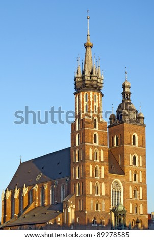 St. Mary's Basilica (Mariacki Church) - famous brick gothic church in Cracow (Krakow), Poland built in 13th-14th century, seen in late evening summer light - stock photo