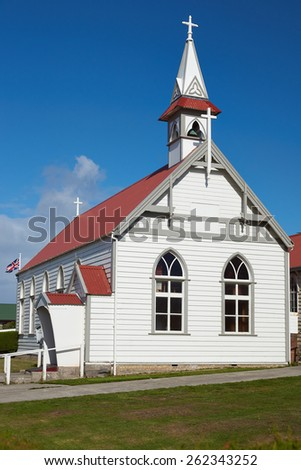 St Mary's Catholic Church in Stanley, capital of the Falkland Islands. Small wooden building with white walls and red tiled roof. - stock photo