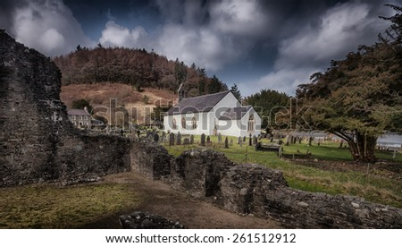 St Michael's church in Talley village, Carmarthen, mid Wales, next to the ruins of Talley Abbey - stock photo