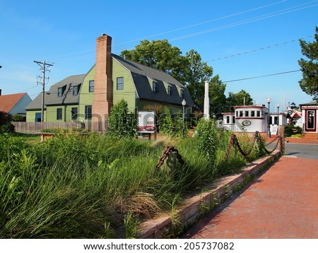 ST. MICHAELS - JULY 1: A street scene close to the water includes The Chesapeake Bay Maritime Museum, in Talbot County on July 1, 2014,  in the historic seaside town of St. Michaels, MD.   - stock photo