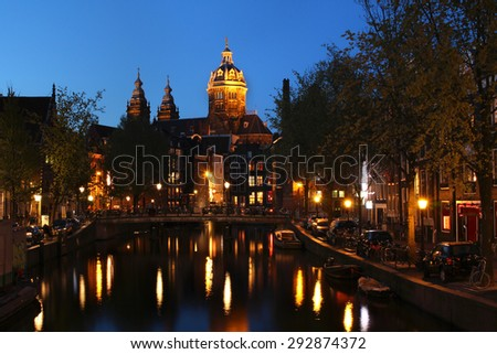 St Nichloas Church from the Red-light district, Amsterdam, The Netherlands - stock photo