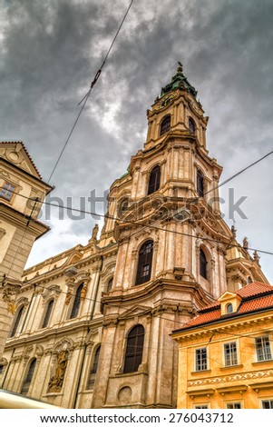 St.Nicholas Church in the quarter of Mala Strana in Prague in Central Europe - stock photo