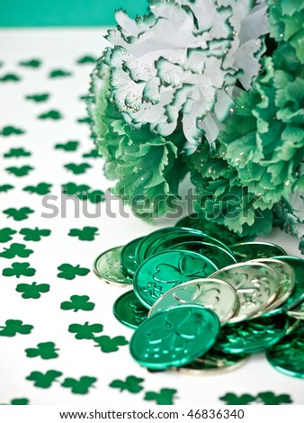 St. Patrick's Day inspired still-life of carnations and coins - stock photo