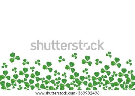 St Patricks Day bottom border of shamrocks over a white background - stock photo