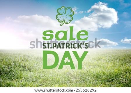 St patricks day sale ad against sunny landscape - stock photo