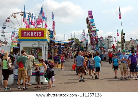 ST. PAUL - AUGUST 26:  People walk through the Midway at the Minnesota State Fair in St. Paul, on August 26, 2012.  Attendance is averaging 139,000 per day in 2012. - stock photo