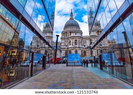 St Paul Cathedral (London) reflected against windows of modern buildings - stock photo