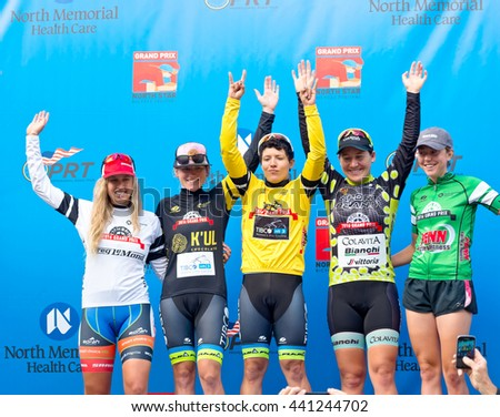 ST. PAUL, MINNESOTA - JUNE 15, 2016: Professional cycling competition winners atop podium at North Star Grand Prix stage one women's time trial in St. Paul on June 15.  - stock photo