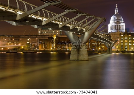 St Paul's and the City of London from the south bank of the River Thames near Millenium Bridge - stock photo