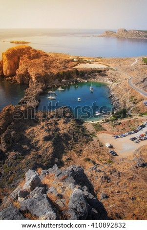 St Paul's Bay and heart shaped lake near Acropolis of Lindos, Rhodes, Greece - stock photo