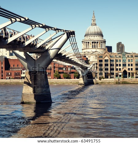 St. Paul's Cathedral and Millennium Bridge, London - stock photo