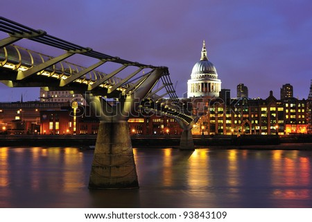 St Paul's Cathedral and the Millenium bridge at dusk, London - stock photo