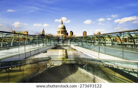 St Paul's Cathedral and the Millennium Bridge in London - stock photo
