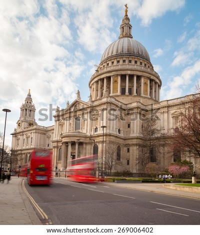 St Paul's Cathedral and Traffic during the day showing double decker buses on the road - stock photo