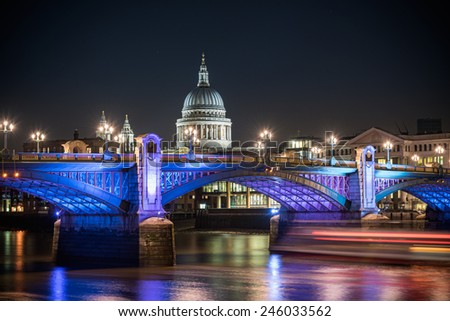 St Paul's Cathedral famous landmark of London poking behind Southwark bridge, London , England. - stock photo