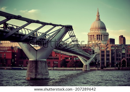 St Paul's cathedral in London and bridge over Thames River.  - stock photo