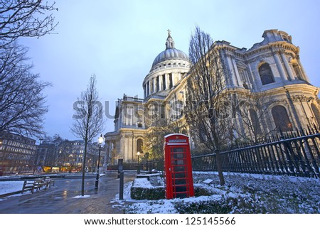 St Paul's Cathedral, locates at the top of Ludgate Hill in the City of London, and red phonebooth - stock photo
