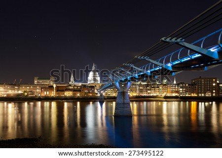 St. Paul's cathedral & the Millennium bridge at night - stock photo