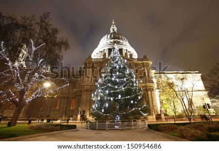 St Paul's Cathedral with christmas decoration locates at the top of Ludgate Hill in the City of London   - stock photo