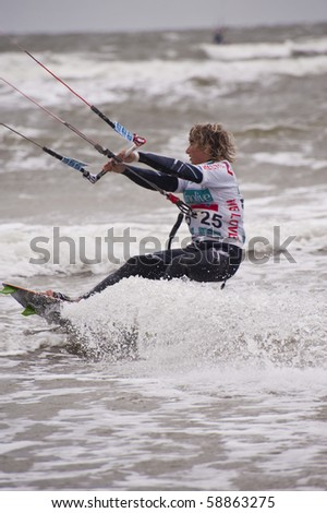 ST. PETER-ORDING, GERMANY - JULY 24: Professional kite-surfer demonstrating his ability on the Palmolive Kitesurf Worldcup 2010, July 24, 2010 in St. Peter-Ording, Germany