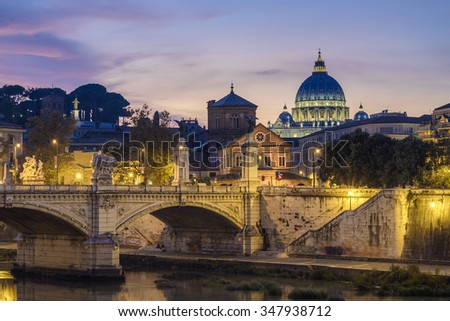 St. Peter's cathedral (Basilica di San Pietro) and bridge over river Tiber at evening, Rome, Italy, Europe - stock photo