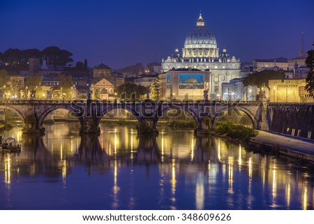 St. Peter's cathedral (Basilica di San Pietro) and bridge over river Tiber in the morning before sunrise, Rome, Italy, Europe - stock photo