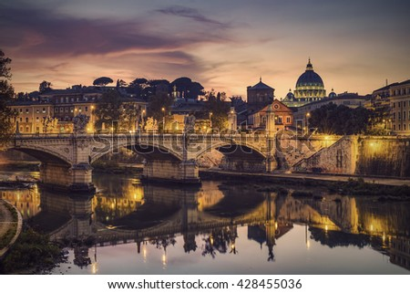 St. Peter's cathedral (Basilica di San Pietro) and bridge (Ponte Vittorio Emanuele II) over river Tiber in the evening after sunrise, Rome, Italy, Europe, Vintage filtered style