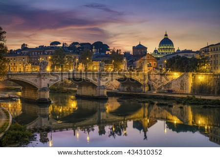 St. Peter's cathedral (Basilica di San Pietro) and bridge (Ponte Vittorio Emanuele II) over river Tiber in the evening after sunrise, Rome, Italy, Europe