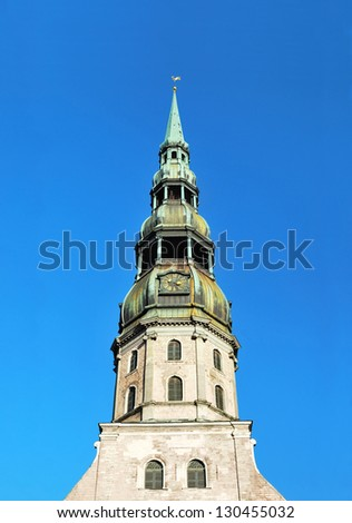 St. Peters church in Riga against clear blue sky - stock photo