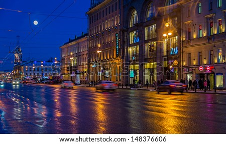 ST. PETERSBURG - CIRCA MARCH 2013: Nevsky Prospect Ave. in St. Petersburg, circa March 2013. This is a tourist attraction with 221 museums, 2000 libraries, and 80  plus theaters within the city. - stock photo