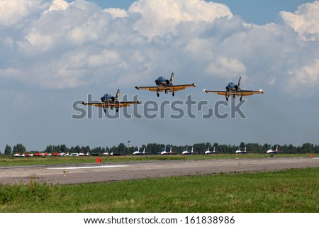 ST.-PETERSBURG - JUL 04: The aerobatic group Russ the participants of the airshow on International maritime defence show (IMDS-2013) on Jul 04, 2013 at airfield Pushkin in St.-Petersburg, Russia