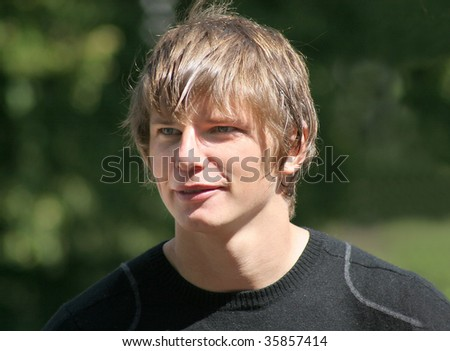 ST. PETERSBURG - JULY 18 : Arsenal football (soccer) player - Andrey Arshavin speaks to the Press July 18, 2008 in St. Petersburg, Russia. - stock photo