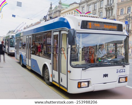 ST PETERSBURG - MAY 29, 2011: A trolleybus of route 1 drives along Nevsky Prospekt in the downtown. There are many kinds of public transport in the city: metro, buses, trams, trolleybuses and taxis. - stock photo