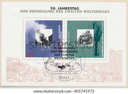 ST. PETERSBURG, RUSSIA - APR 14, 2016: A first day of issue postmark printed in Bonn, Germany, shows ruins and refugees. 50th anniversary of the termination of the second world war, circa 1995 - stock photo