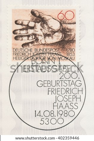 ST. PETERSBURG, RUSSIA - APR 7, 2016: A first day of issue postmark printed in Bonn, Germany, shows Helping Hand. Dr. Friedrich Joseph Haass (1780-1853), physician and philanthropist, circa 1980 - stock photo