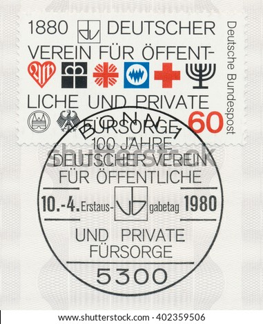 ST. PETERSBURG, RUSSIA - APR 7, 2016: A first day of issue postmark printed in Bonn, Germany, shows Simbols. German Association for Public and Private Social Welfare Centenary, circa 1980 - stock photo