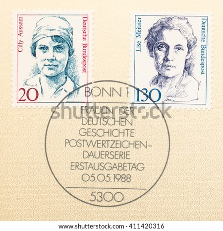 ST. PETERSBURG, RUSSIA - APR 25, 2016: A first day of issue postmark printed in Germany, shows portraits of Cilly Aussem (1909-63), tennis champion and Lise Meitner (1878-1968), physicist, circa 1988 - stock photo