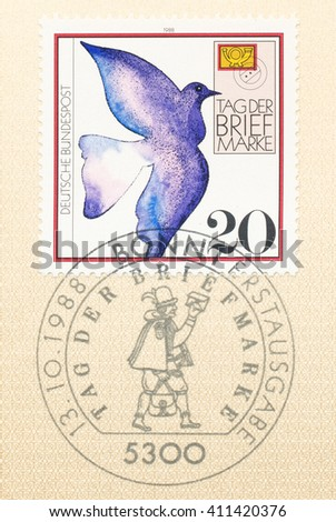 ST. PETERSBURG, RUSSIA - APR 25, 2016: A first day of issue postmark printed in Germany, shows Carrier pigeon and Postman, Stamp Day, circa 1988 - stock photo