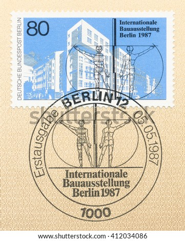 ST. PETERSBURG, RUSSIA - APR 27, 2016: A first day of issue postmark printed in Germany, shows building and the figure of a man, International Architecture Exhibition, circa 1987 - stock photo
