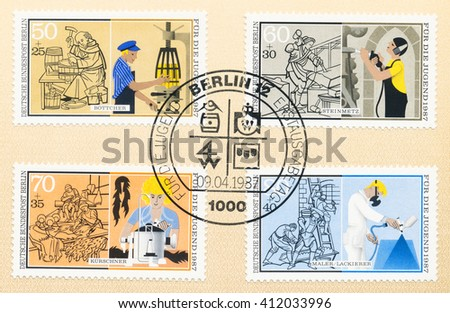 ST. PETERSBURG, RUSSIA - APR 27, 2016: A first day of issue postmark printed in Germany, shows old and new Cooper, Stonemason,  Furrier,  Painter, circa 1987 - stock photo